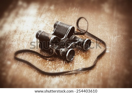 Military binoculars since World War II. Retro style for the holiday May 9 Victory - stock photo