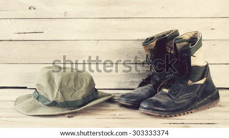 military caps and military boots - stock photo