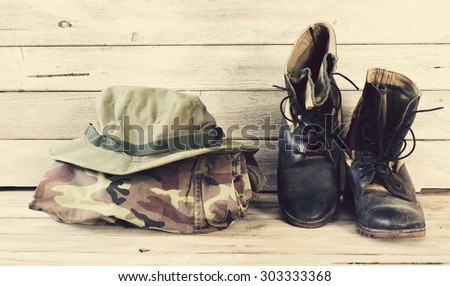 military caps,military boots and military shirt - stock photo