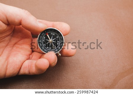 military compass in hand - stock photo