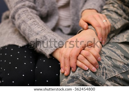 Military couple holding hands, married caucasian, Air Force. - stock photo