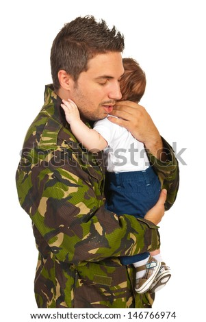 Military dad hugging his newborn baby son isolated on white background - stock photo