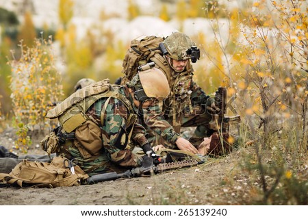 military doctor to help the wounded hostage - stock photo