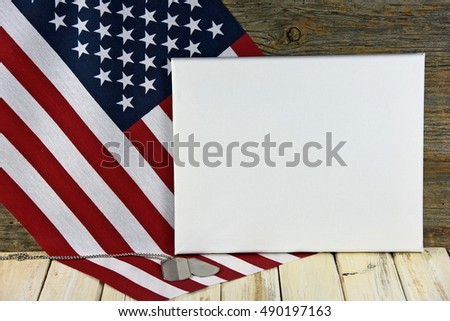military dog tags and blank white canvas on American flag