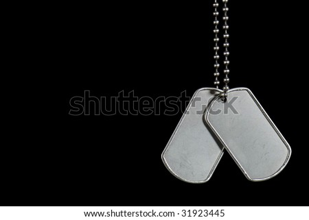 military dog tags on black