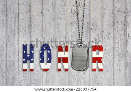 military dog tags with honor in star and stripe design on weathered wood background