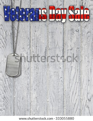 military dog tags with patriotic flag Veterans Day Sale sign on weathered wood - stock photo