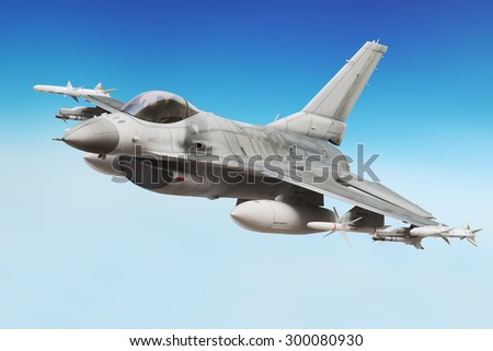 Military F16 fighter jet close up soaring through the air - stock photo