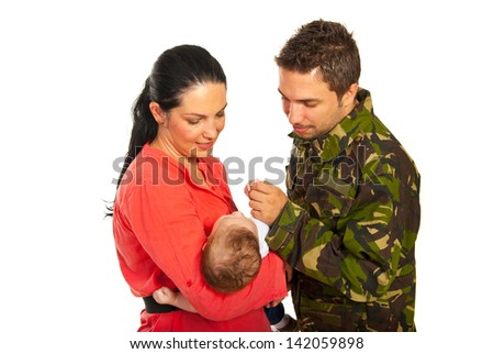 Military father came home and meeting his newborn baby son isolated on white background - stock photo