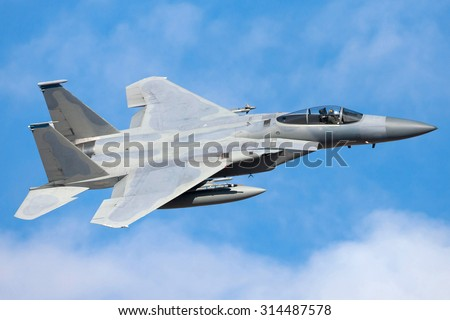 Military fighter aircraft flying - stock photo