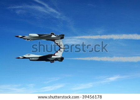 Military fighter jet during demonstration - stock photo