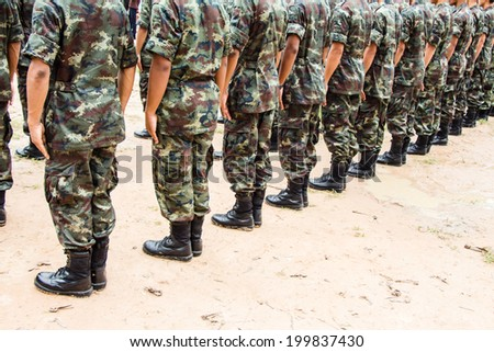 Military force uniform soldier boot row - stock photo