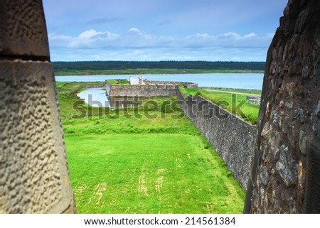 Military fortifications in Fortress of Louisbourg, Nova Scotia, Canada - stock photo