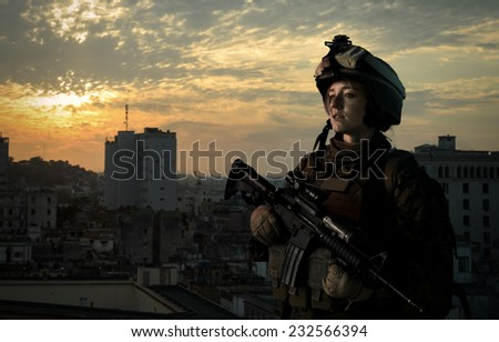 Military girl in uniform of the U.S. Army looks into the distance. Hostilities. - stock photo