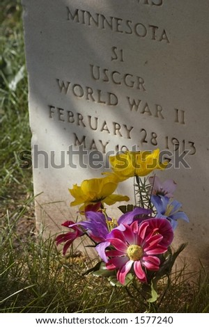 Military Gravestone and Flowers - Vertical - stock photo