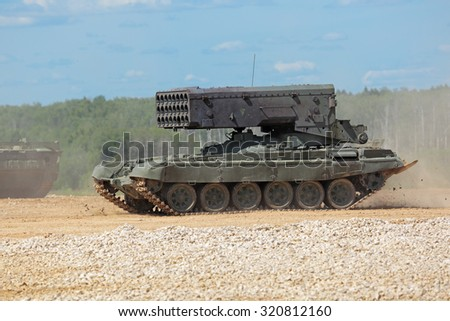 MILITARY GROUND ALABINO, MOSCOW OBLAST, RUSSIA - JUN 18, 2015: Heavy Flamethrower System TOS-1 (multiple rocket launcher and thermobaric weapon) at the International military-technical forum ARMY-2015 - stock photo