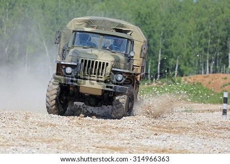 MILITARY GROUND ALABINO, MOSCOW OBLAST, RUSSIA - JUN 18, 2015: The demonstration of the capabilities of a military truck Ural-43206 at the International military-technical forum ARMY-2015