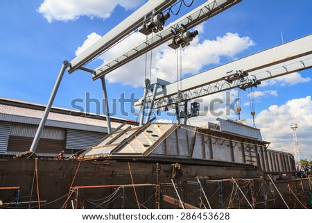 Military gun boat under construction, supper structure assembly step - stock photo