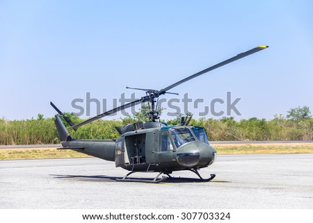 Military helicopter (huey) at a base - stock photo