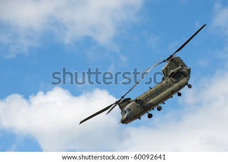 military helicopter in a steep flight maneuver - stock photo
