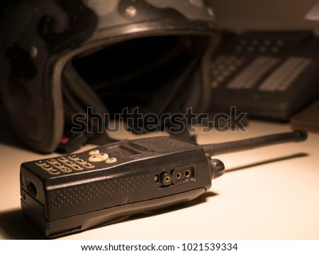 military helmet and transmitter, the phone on the table
