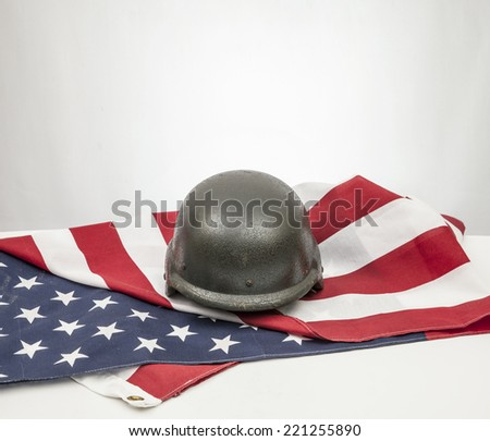 Military helmets and American flag on white background.  - stock photo
