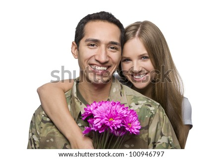 Military Husband and Wife Smile with Flowers