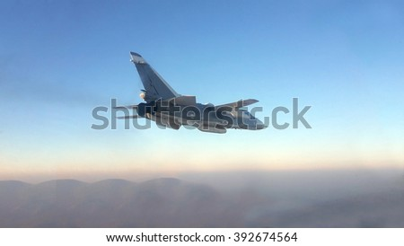 Military jet bomber  flying above the clouds.