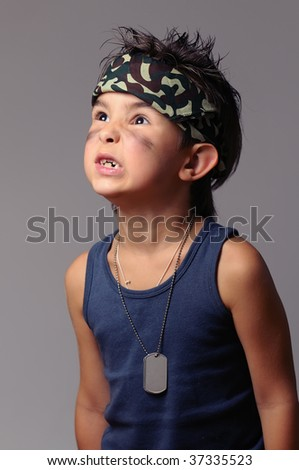 Military kid in bandana with dog tag screams at someone - stock photo