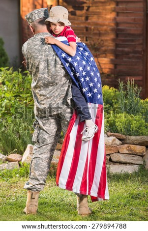 Military man father hugs son. Portrait of happy american family - stock photo