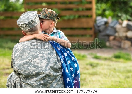 Military man father hugs son. Portrait of happy american family. focus on father back - stock photo