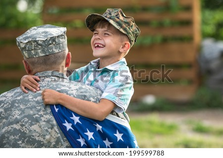 Military man father hugs son. Portrait of happy american family. focus on fathers back - stock photo