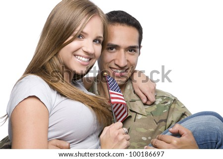 Military Man has Happy Wife in His Arms