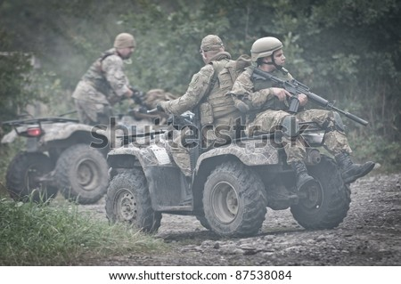 Military man on all terrain vehicle