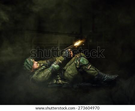 Military man soldier shooting  of handgun. Dark mist background - stock photo