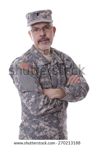 Military man standing with folding arms, studio on white background