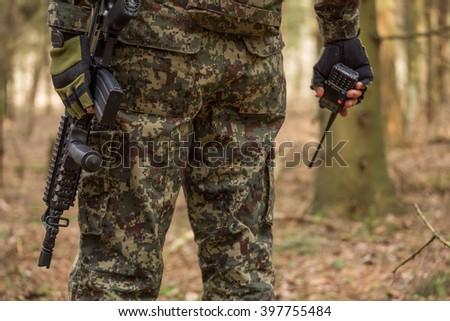 Military man with radio outdoor, He said on the radio - stock photo
