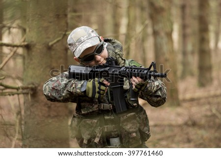 Military man with Rifle M16 outdoor forest,