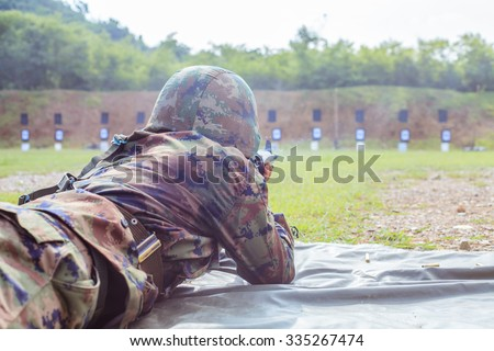 Military maneuvers, gunnery training in the forest . Military training, Military student weapons - stock photo