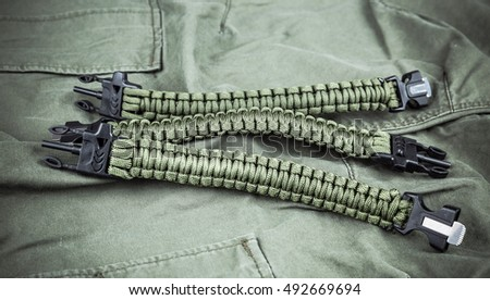 Military paracord bracelets on army-green fabric
