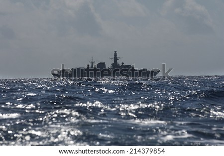 military peacekeeping patrol ship on the high seas against pirates and terrorists - stock photo