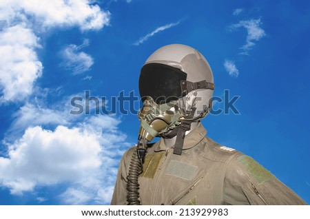 military pilot on blue sky background