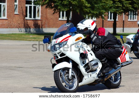military police intervention.  Officer on bike in pursuit of suspect.  Safety, speed concept. - stock photo