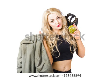 Military portrait of a Russian pin up woman holding gas mask and army coat on white background. Nuclear warfare pinups - stock photo