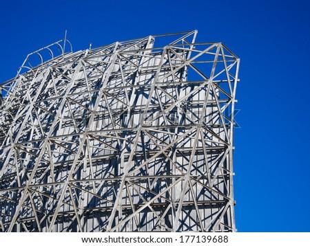 Military radar station against blue sky - stock photo