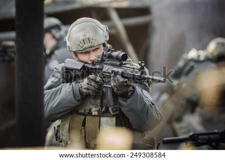 military ranger shooting an assault rifle - stock photo