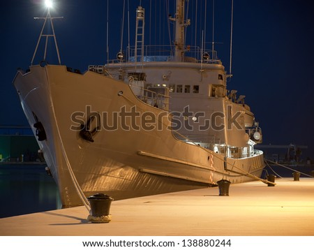 military ship anchored in winter night - stock photo