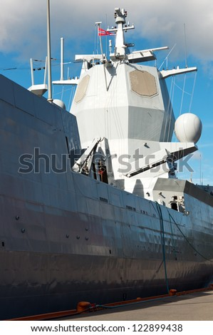 Military ship with radar system at the pier - stock photo