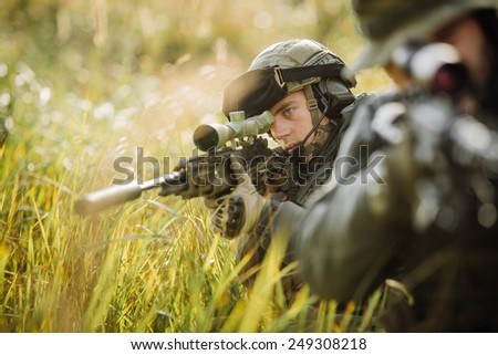 military sniper shooting an assault rifle - stock photo