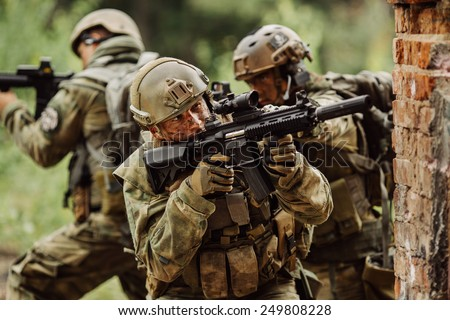 military solders stormed the building - stock photo